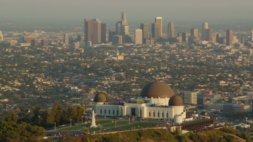 1080 stock footage aerial video orbit the Griffith Observatory at sunset, and reveal the Downtown Los Angeles skyline, California Aerial Stock Footage | HDA06_09