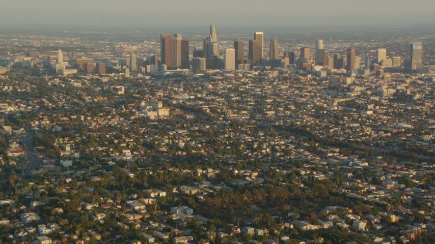 1080 aerial video fly over Silver Lake neighborhoods to approach Downtown Los Angeles at sunset, California Aerial Stock Footage | HDA06_13