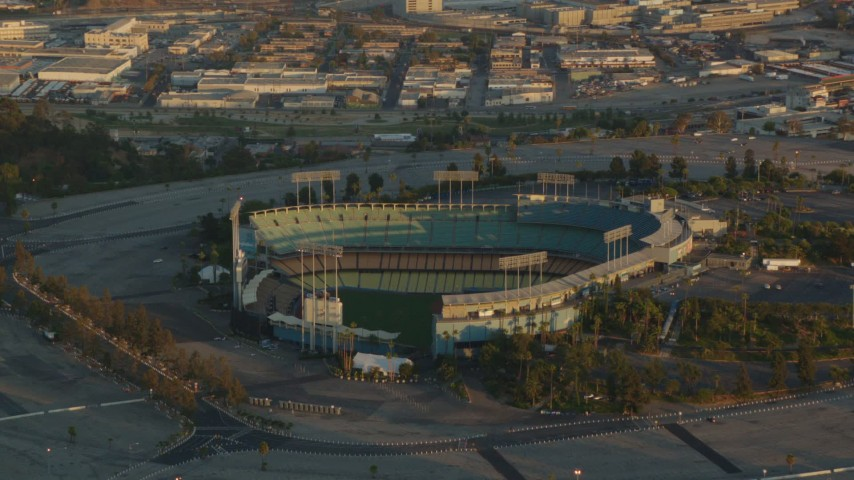 1080 stock footage aerial video approaching the Dodger Stadium baseball stadium at sunset, Los Angeles, California Aerial Stock Footage | HDA06_17
