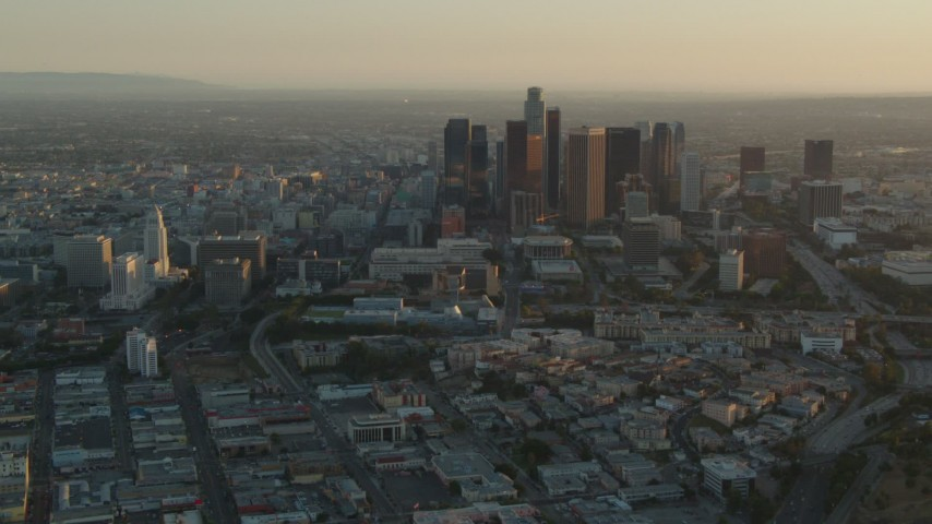 1080 stock footage aerial video Los Angeles City Hall and skyscrapers at sunset in Downtown Los Angeles, California Aerial Stock Footage | HDA06_20