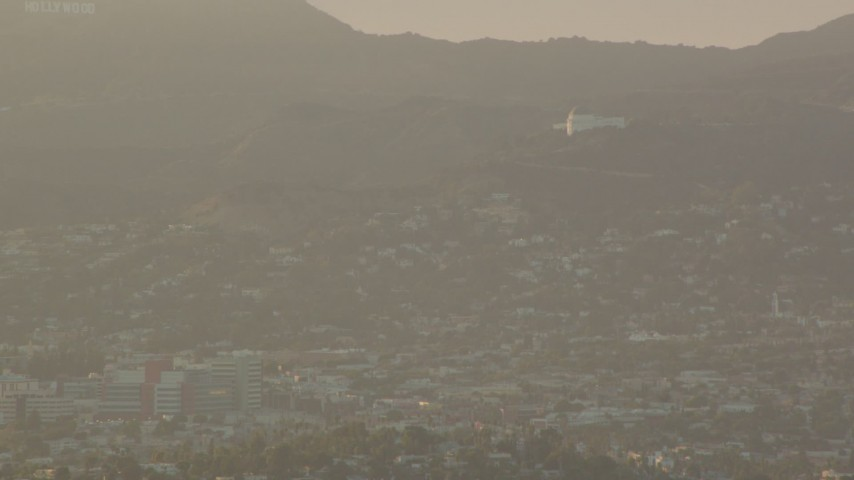 1080 stock footage aerial video Griffith Observatory at sunset, seen from Downtown Los Angeles, California Aerial Stock Footage | HDA06_22