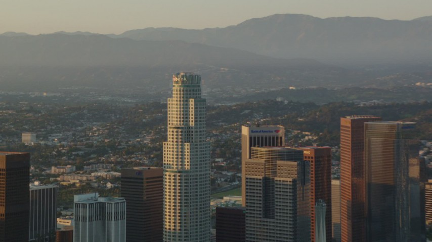 1080 aerial video orbit US Bank Tower, zoom to reveal the rest of Downtown Los Angeles at sunset, California Aerial Stock Footage | HDA06_24
