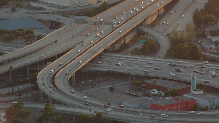 1080 stock footage aerial video interchange between the 110 and 10 freeways at sunset in Downtown Los Angeles, California Aerial Stock Footage | HDA06_35