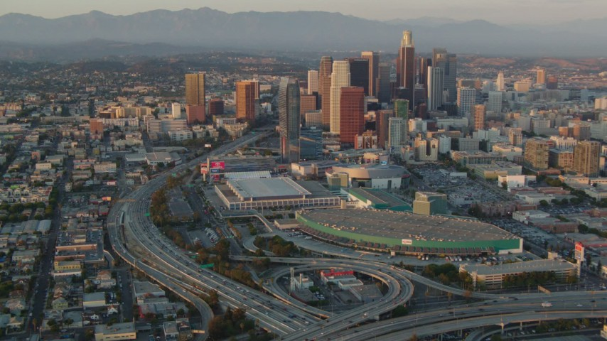 1080 stock footage aerial video the 110 and 10 freeway interchange, LA Convention Center, and Downtown Los Angeles, California at sunset Aerial Stock Footage | HDA06_37