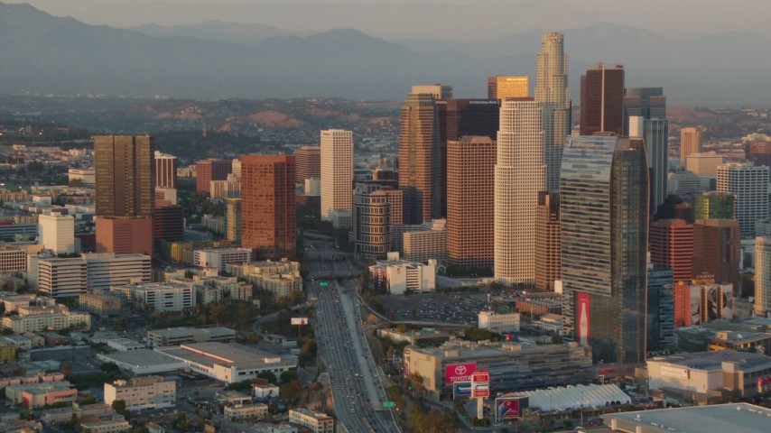 1080 aerial video Downtown Los Angeles skyscrapers in the 110 freeway at sunset, California Aerial Stock Footage | HDA06_38