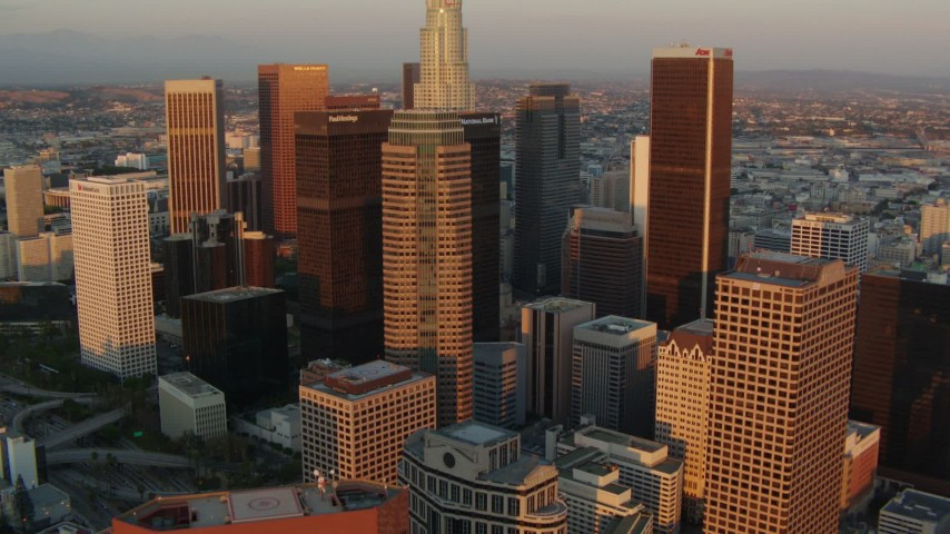 1080 stock footage aerial video fly over Downtown Los Angeles past Figueroa at Wilshire and CityNational Plaza at sunset, California Aerial Stock Footage | HDA06_41