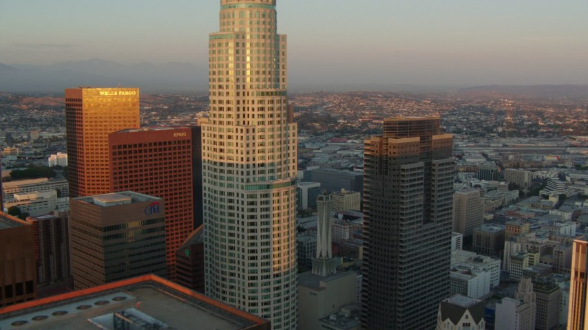 1080 aerial video approach US Bank Tower and Gas Company Tower at sunset in Downtown Los Angeles, California Aerial Stock Footage | HDA06_42