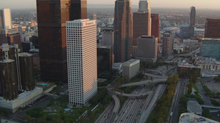 1080 stock footage aerial video tilt from 110 freeway to reveal skyscrapers at sunset in Downtown Los Angeles, California Aerial Stock Footage | HDA06_44