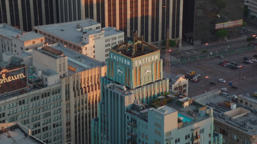 1080 stock footage aerial video orbit the Eastern Columbia Building to reveal the Orpheum Theater at sunset, Downtown Los Angeles, California Aerial Stock Footage | HDA06_49