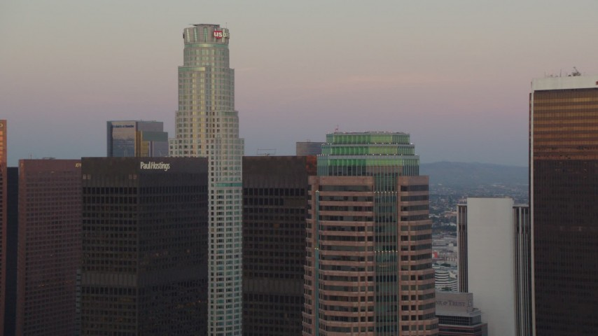 1080 stock footage aerial video US Bank Tower and skyscrapers at twilight in Downtown Los Angeles, California and zoom to wider view Aerial Stock Footage | HDA06_58
