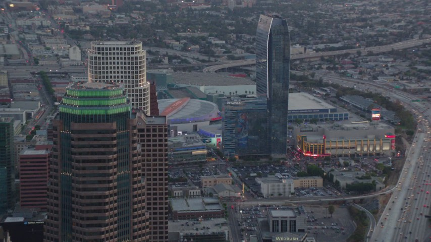 1080 aerial video flyby skyscrapers in Downtown Los Angeles at twilight to reveal Staples Center and Ritz-Carlton in California Aerial Stock Footage | HDA06_63