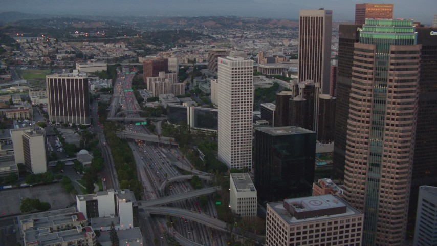 1080 stock footage aerial video tilt to light traffic on the 110 freeway by skyscrapers in Downtown Los Angeles, California, twilight Aerial Stock Footage | HDA06_68