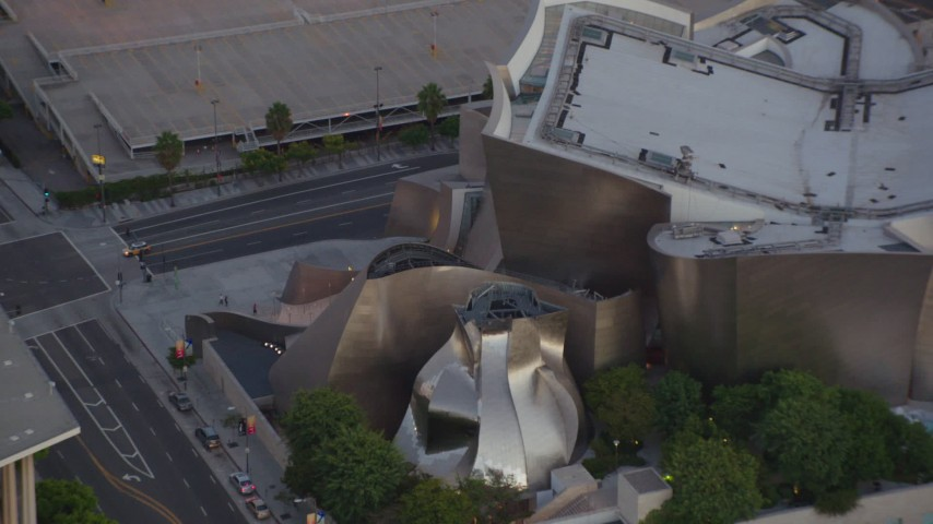 1080 stock footage aerial video orbit Walt Disney Concert Hall, tilt to reveal skyscrapers in Downtown Los Angeles, California at twilight Aerial Stock Footage | HDA06_72