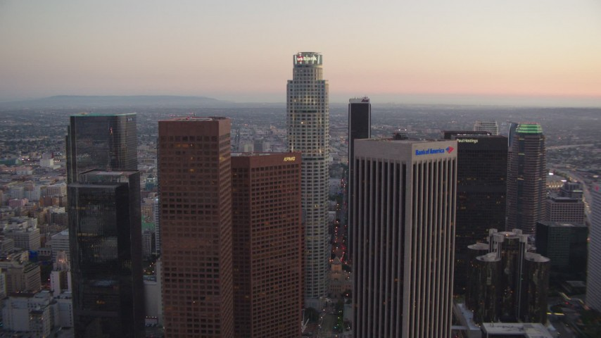 1080 stock footage aerial video tilt up and flyby Bank of America Center to approach Paul Hastings Tower at twilight, Downtown Los Angeles, California Aerial Stock Footage | HDA06_75