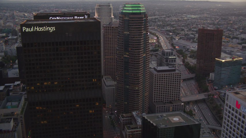1080 stock footage aerial video flyby Downtown Los Angeles skyscrapers at twilight to reveal Staples Center and Ritz-Carlton in California Aerial Stock Footage | HDA06_76