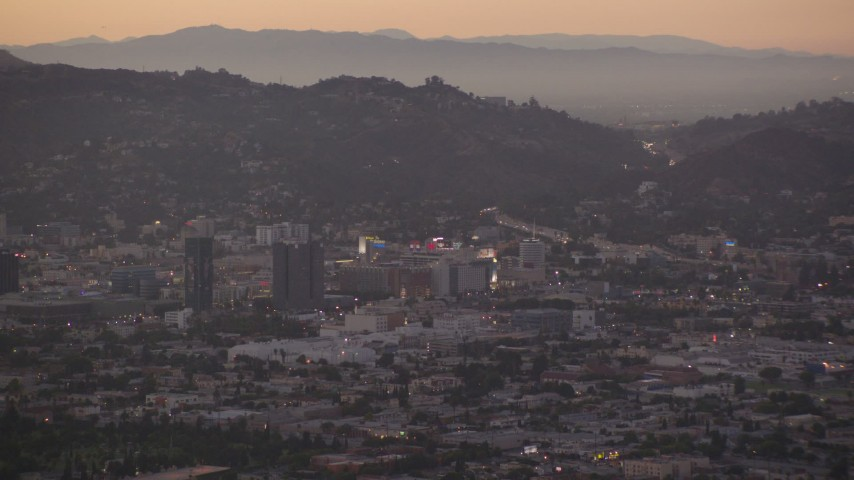 1080 stock footage aerial video approach office buildings and Capitol Records at twilight in Hollywood, California Aerial Stock Footage | HDA06_80