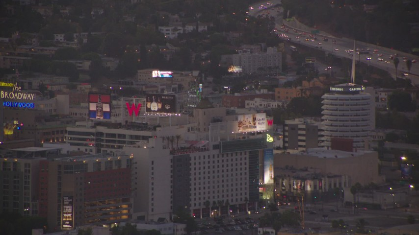 1080 stock footage aerial video approach Capitol Records, hotels, and office buildings at twilight, Hollywood, California Aerial Stock Footage | HDA06_81