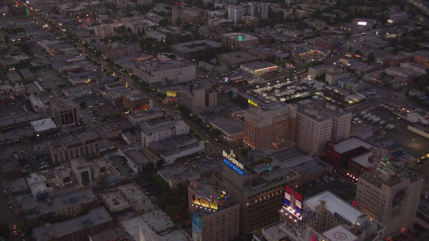 1080 stock footage aerial video fly over office buildings and W Hotel near Capitol Records to follow Hollywood Boulevard at twilight, Hollywood, California Aerial Stock Footage | HDA06_82