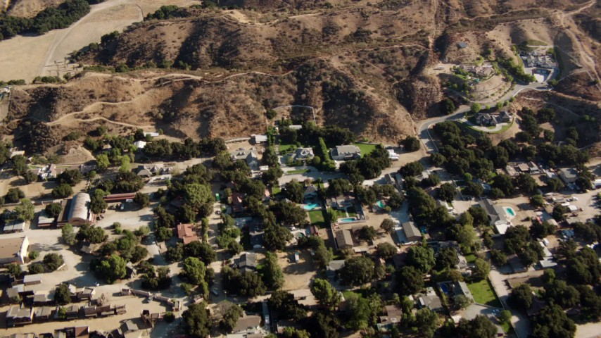 1080 stock footage aerial video fly over homes and brown hills in Newhall, California Aerial Stock Footage | HDA07_17