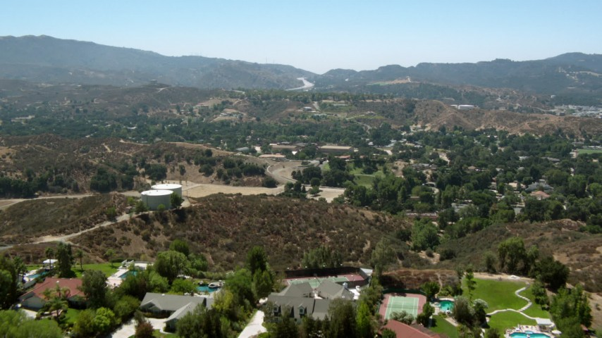 1080 aerial video of flying over hills and homes in Newhall, California Aerial Stock Footage | HDA07_24