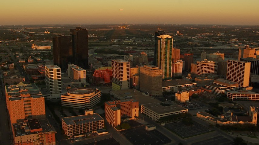 1080 stock footage aerial video of flying by tall skyscrapers at sunset in Downtown Fort Worth, Texas Aerial Stock Footage HDA12_002   Axiom Images