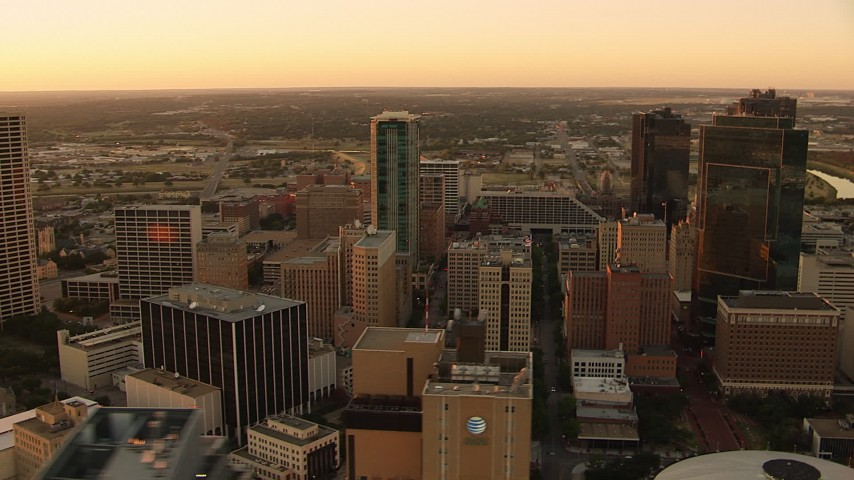 1080 stock footage aerial video of passing tall high-rises buildings at sunset in Downtown Fort Worth, Texas Aerial Stock Footage | HDA12_009