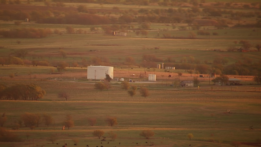 1080 stock footage aerial video of a large tank and farmland at sunrise, Red River, Texas Aerial Stock Footage | HDA12_052
