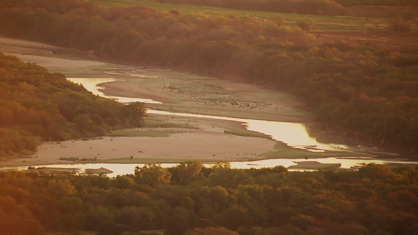 1080 stock footage aerial video of flying by Red River at sunrise, Texas Aerial Stock Footage | HDA12_054