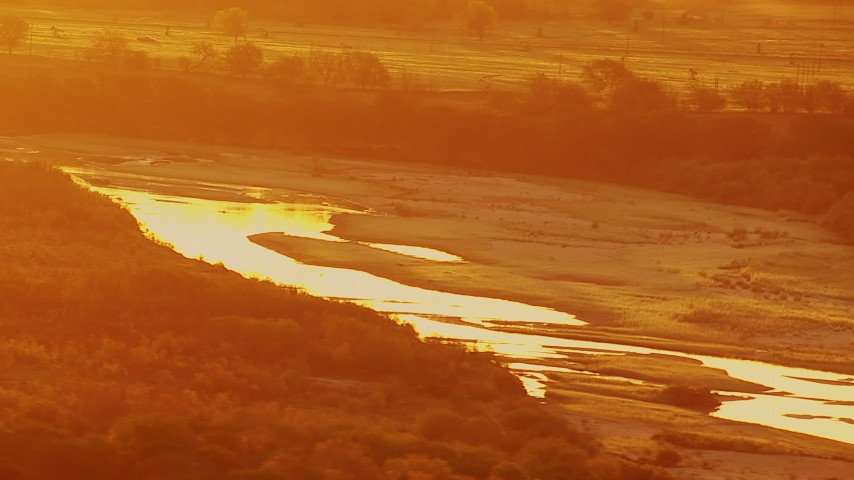 1080 stock footage aerial video of Red River at sunrise, and oil rigs on the Texas side of the border Aerial Stock Footage | HDA12_055