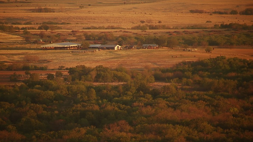 1080 stock footage aerial video of approaching cattle ranch at sunrise in Oklahoma Aerial Stock Footage | HDA12_060