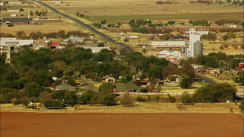 1080 stock footage aerial video of a small town with a highway passing through it in Walters, Oklahoma Aerial Stock Footage | HDA12_081
