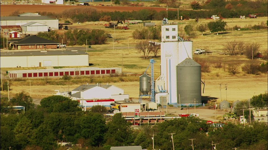 1080 stock footage aerial video of silos in the town of Walters, Oklahoma Aerial Stock Footage | HDA12_082