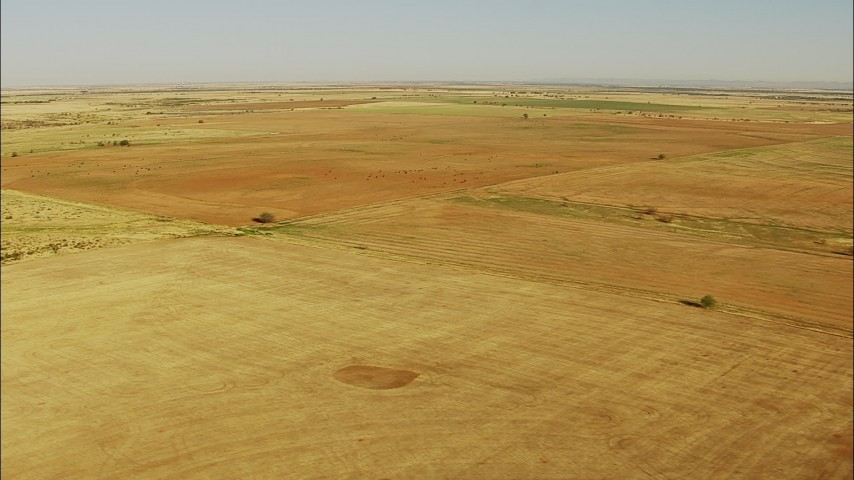 1080 stock footage aerial video pass fields in a vast farm area in Walters, Oklahoma Aerial Stock Footage | HDA12_087