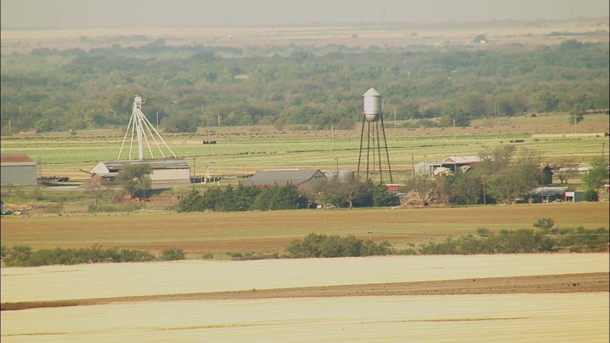 1080 stock footage aerial video of a farm with a water tower in Walters, Oklahoma Aerial Stock Footage | HDA12_089