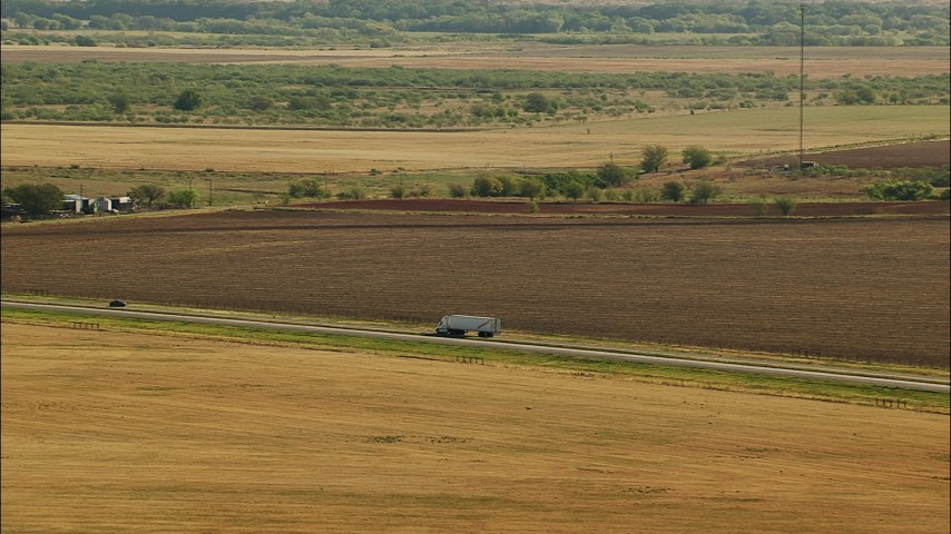 1080 stock footage aerial video of tracking a truck, Highway 44 near Walters, Oklahoma Aerial Stock Footage | HDA12_091
