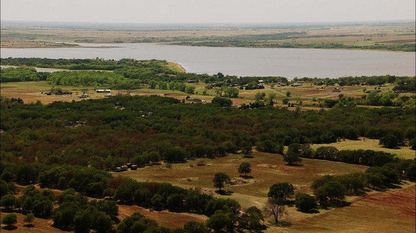 1080 stock footage aerial video of fly over farms to approach a lake in Oklahoma Aerial Stock Footage | HDA12_109