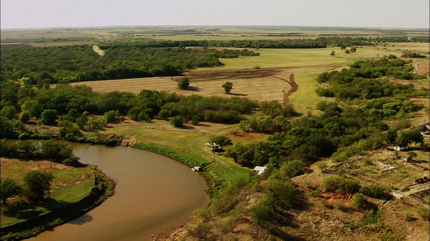 1080 stock footage aerial video of a reverse view of farms, reveal a river in Oklahoma Aerial Stock Footage | HDA12_112