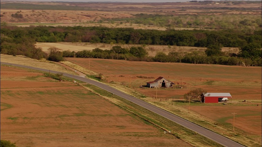 1080 stock footage aerial video of a barn and fields beside a country road, reveal grazing cows in Oklahoma Aerial Stock Footage | HDA12_115