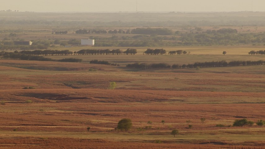 1080 stock footage aerial video of large tanks and farmland at sunset in Oklahoma Aerial Stock Footage   HDA12_130