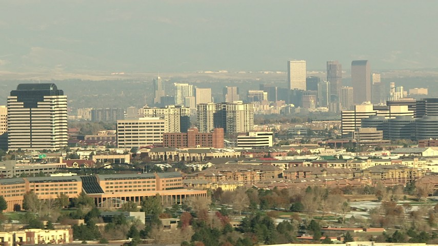 HD stock footage aerial video of the Downtown Denver skyline and office buildings in Colorado Aerial Stock Footage | HDA13_273