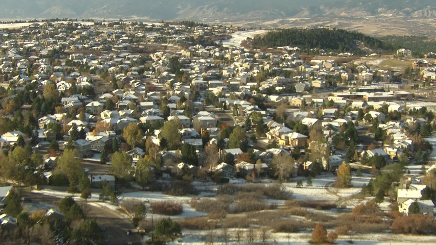 HD aerial stock footage video of flying over homes and snowy fields in Castle Pines, Colorado Aerial Stock Footage | HDA13_278