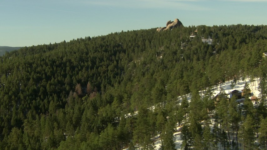 HD stock footage aerial video of flying over homes and forest in the Rocky Mountains, Colorado Aerial Stock Footage | HDA13_286
