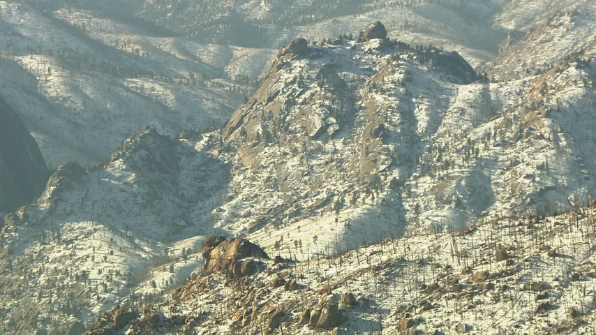 HD stock footage aerial video of a jagged ridge with snow in the Rocky Mountains, Colorado Aerial Stock Footage | HDA13_296