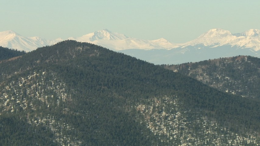 HD stock footage aerial video of mountains with trees and light snow in the Rocky Mountains, Colorado Aerial Stock Footage   HDA13_302
