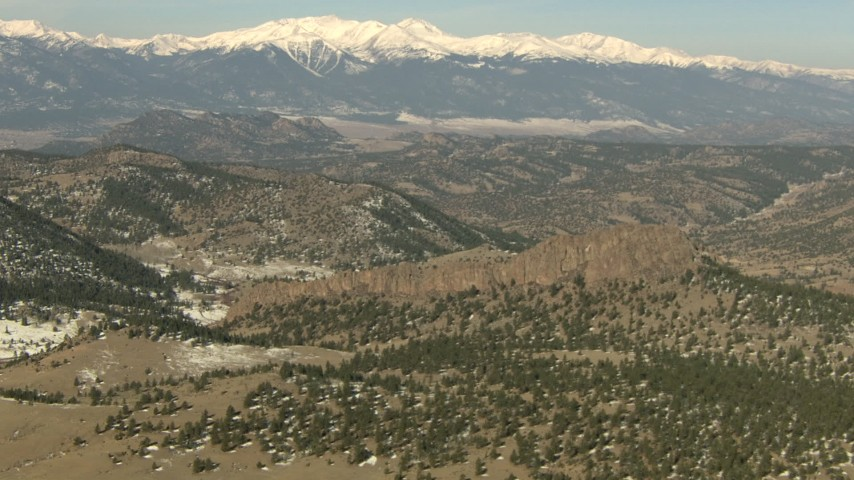 HD stock footage aerial video of hills and snow-capped Rocky Mountains, Colorado Aerial Stock Footage | HDA13_324