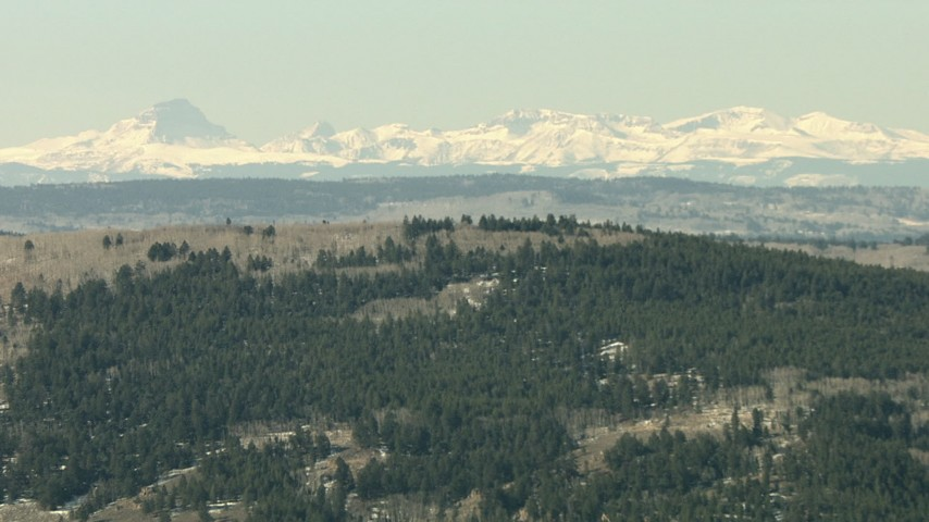 HD stock footage aerial video of a view of the Rocky Mountains beyond a ridge in Colorado Aerial Stock Footage | HDA13_332