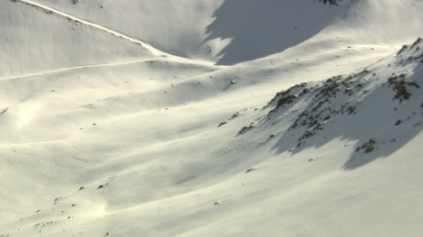 HD stock footage aerial video pan across a slope and fly over ridge in the Rocky Mountains, Colorado Aerial Stock Footage | HDA13_359