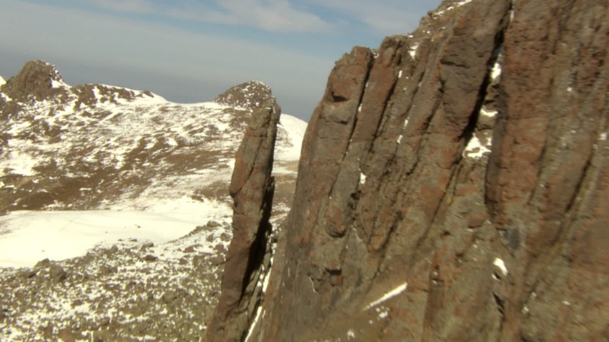HD stock footage aerial video flyby rocky protrusion and over a ridge in the Rocky Mountains, Colorado Aerial Stock Footage   HDA13_376