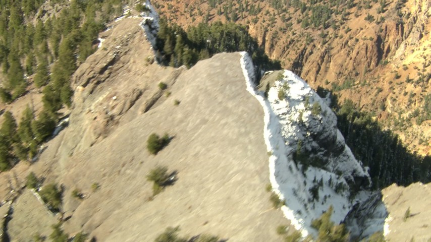 HD stock footage aerial video fly over a ridge to reveal a canyon in the Rocky Mountains, Colorado Aerial Stock Footage | HDA13_378