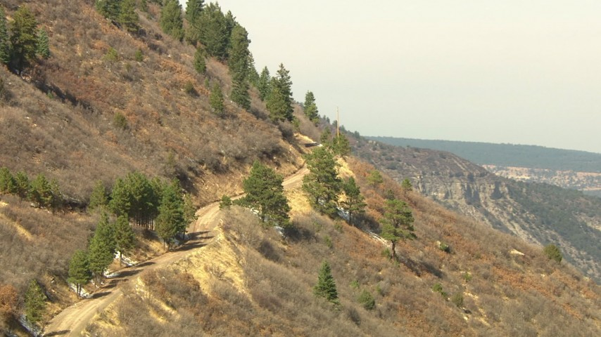 HD stock footage aerial video of a road on a mountain slopes in the Rocky Mountains, Colorado Aerial Stock Footage | HDA13_382